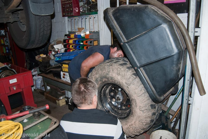 The first stop: E&G Auto Repair LLC for a balance job on Jarek's tyres. George meets us, things are fabricated, things are cursed. As is usual at the shop, people are in and out.