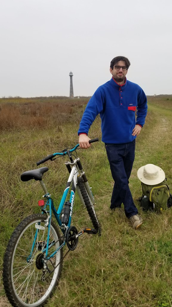 A picture of me cycling to the Matagorda Island Lighthouse in Texas